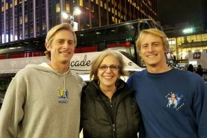 Board members Christian Glaser and Maria Scaros with volunteer Luke Glaser